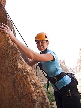 Close up of woman rock climbing