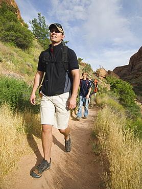 People hiking in desert