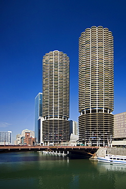 Marina City Towers with boat on Chicago River Chicago Illinois USA