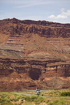 Airplane on runway in canyon, Moab, Utah, United States