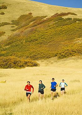 Group of people running in field, Salt Flats, Utah, United States