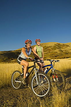 Two women on mountain bikes, Salt Flats, Utah, United States