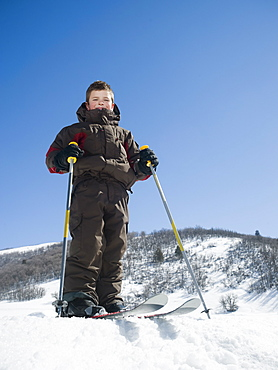 Boy standing on skis