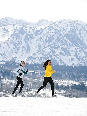 Women running in snow
