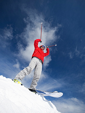 Man on skis with arms raised