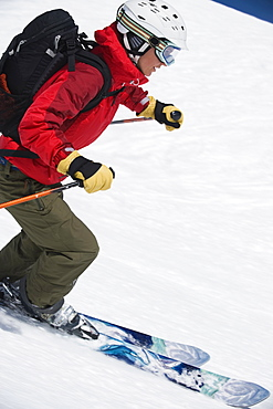 Woman skiing downhill