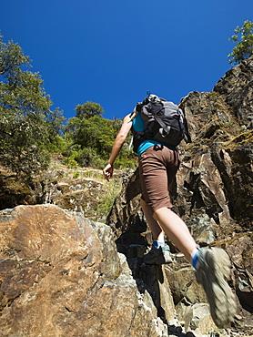 Hiker ascending rocky trail