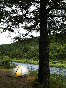 Tent and campsite by river