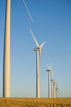 Row of windmills on wind farm