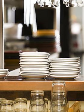 Clean dishes in restaurant