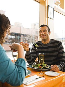 Couple eating in restaurant