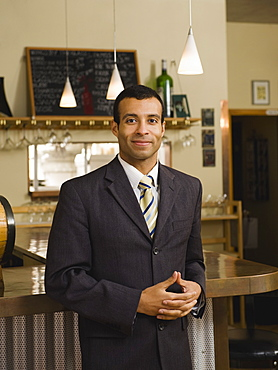 Businessman posing in restaurant