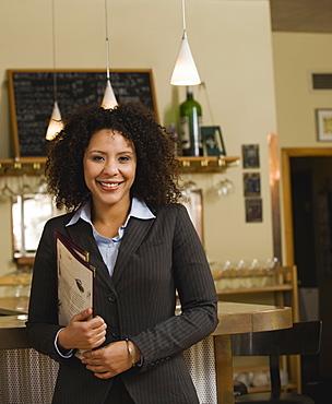 Businesswoman posing in restaurant