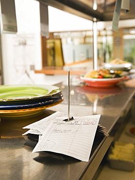Food order spike in restaurant kitchen
