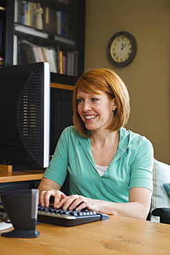 A woman in a home office