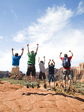 A father with kids at Red Rock jumping