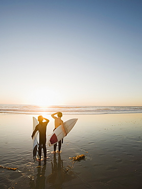 Kids on beach with surfboards