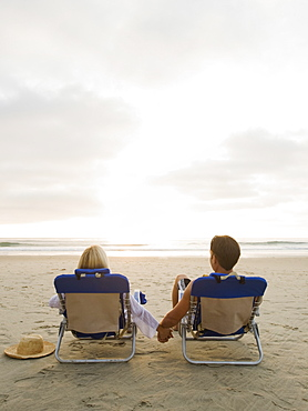 Couple relaxing at the beach
