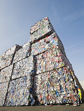 Stacks of crushed aluminum cans