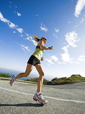 Woman running on a road in Malibu