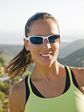 Trail runner wearing sunglasses