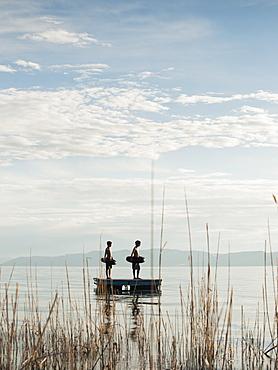 Boys (10-11,12-13) jumping from raft