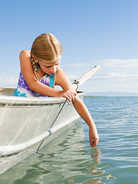 Girl (8-9) playing on boat
