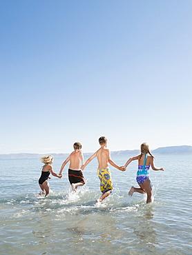 Kids (6-7,8-9,10-11,12-13) playing in lake