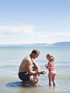 Father and daughter (2-3) at lake