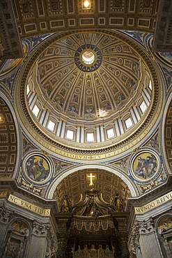 Interior view of dome and canopy in St. Peter's Basilica, Vatican City, Italy
