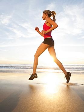 USA, California, Los Angeles, woman jogging on beach