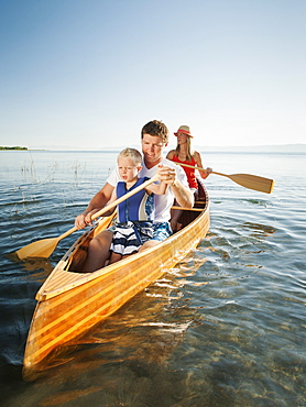 Family with son (4-5) canoe traveling