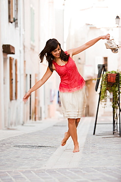 France, Cassis, Young woman balancing on curbstone, France, Cassis