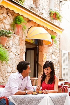 France, Cassis, Couple sitting in cafe drinking coffee, France, Cassis