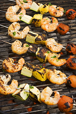 Shish kebab cooking on grill