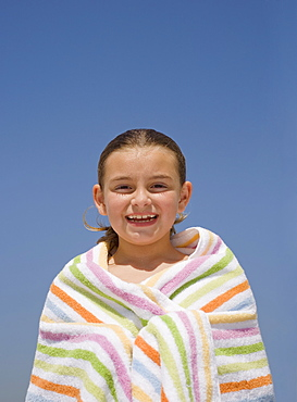 Girl wrapped in beach towel