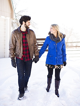 Young couple walking outdoors in winter