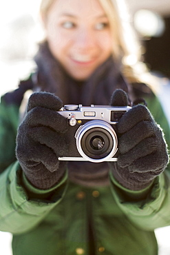 Woman holding old-fashioned camera