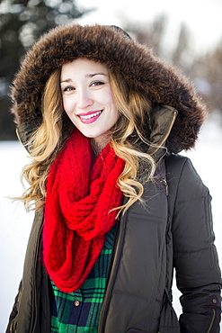 Portrait of woman wearing red scarf smiling outdoors