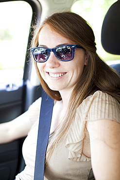 Portrait of young woman in car, USA, Utah, Salt Lake