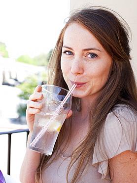 Portrait of young woman drinking water, USA, Utah, Salt Lake