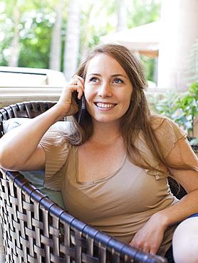 Portrait of young woman talking via mobile, USA, Utah, Salt Lake