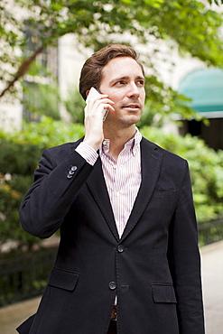 Portrait of elegant man talking on phone, USA, New York State, New York