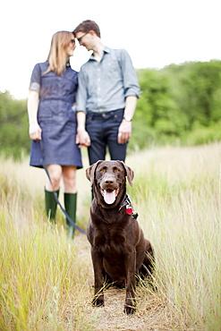 Portrait of young couple with dog, USA, Utah, Salt Lake City