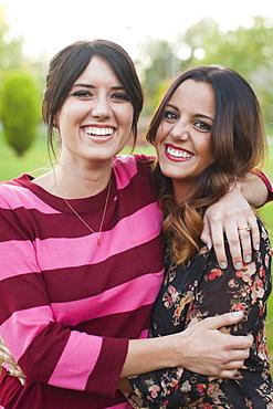 Portrait of two young women embracing, Salt Lake City, Utah