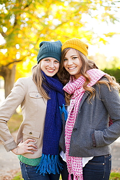 Portrait of two young women wearing hats and scarves
