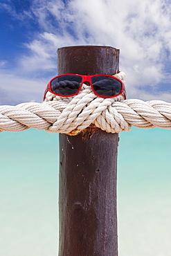 Sunglasses on wooden post, Mexico, Quintana Roo, Yucatan Peninsula, Cancun