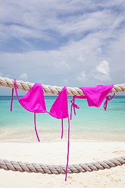 Pink bikini drying on rope, Mexico, Quintana Roo, Yucatan Peninsula, Cancun