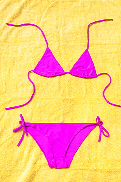 Bikinis lying on towels on beach, Mexico, Quintana Roo, Yucatan Peninsula, Cancun