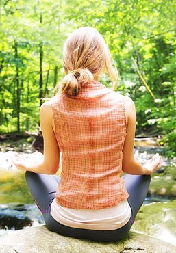 Woman practicing joga in forest, USA, New Jersey, Mendham